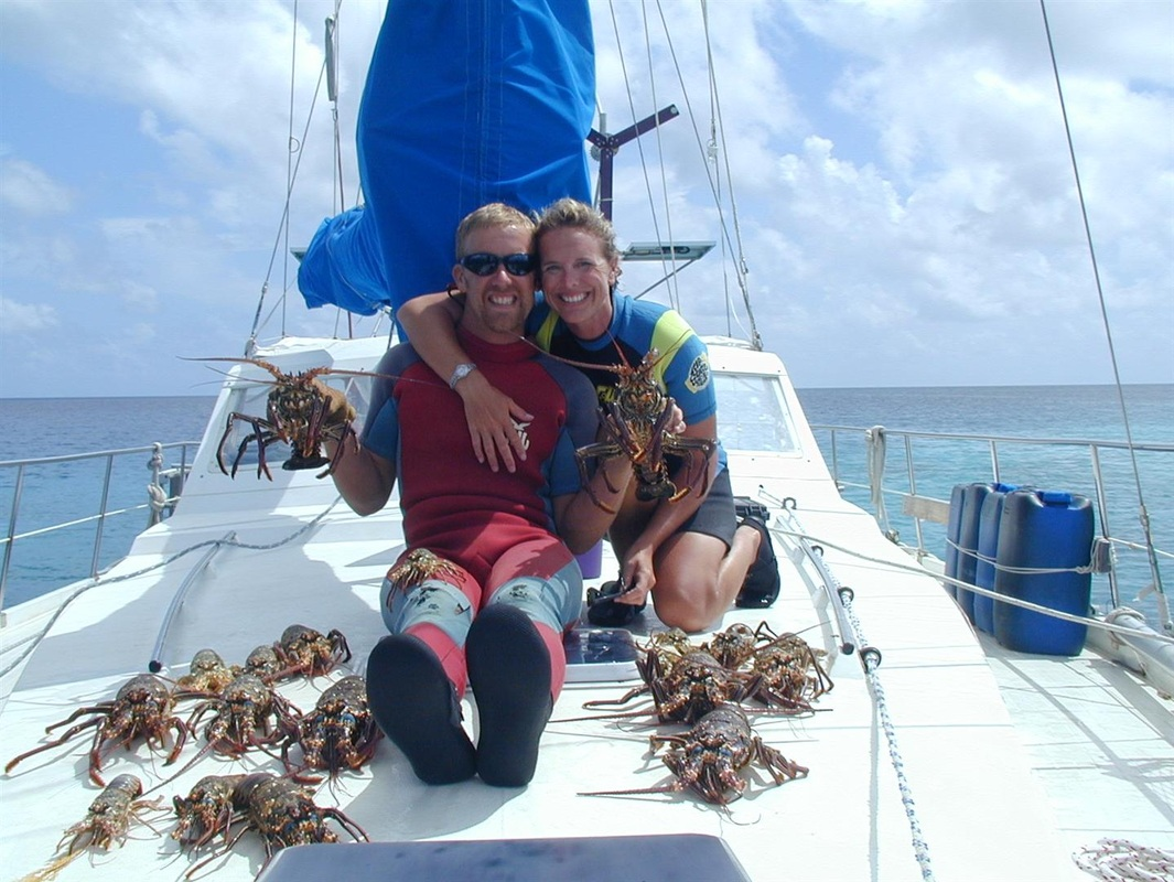 Paul, Kelly and lots of lobsters in Minerva Reef, South Pacific